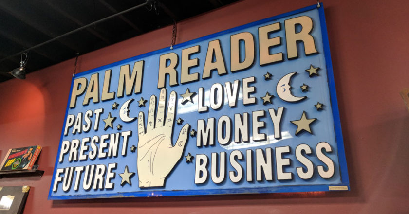 Palm Reader sign in the Hereafter Hauntings exhibit at The Mystic Museum