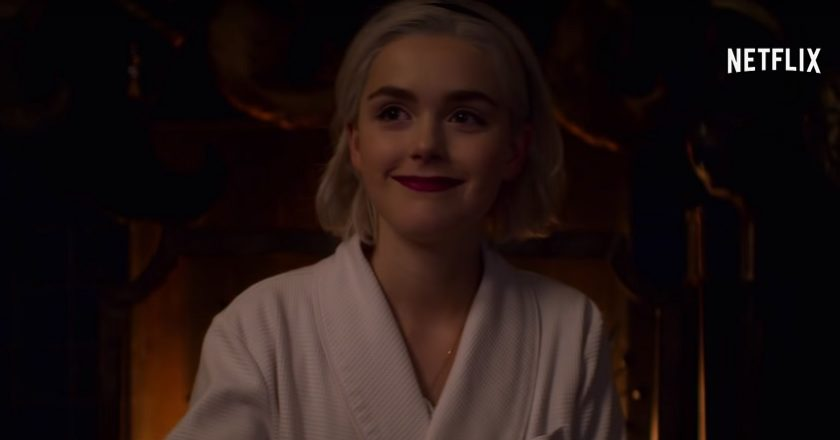 A scene from Chilling Adventures of Sabrina: A Midwinter's Tale with Sabrina Spellman smiling