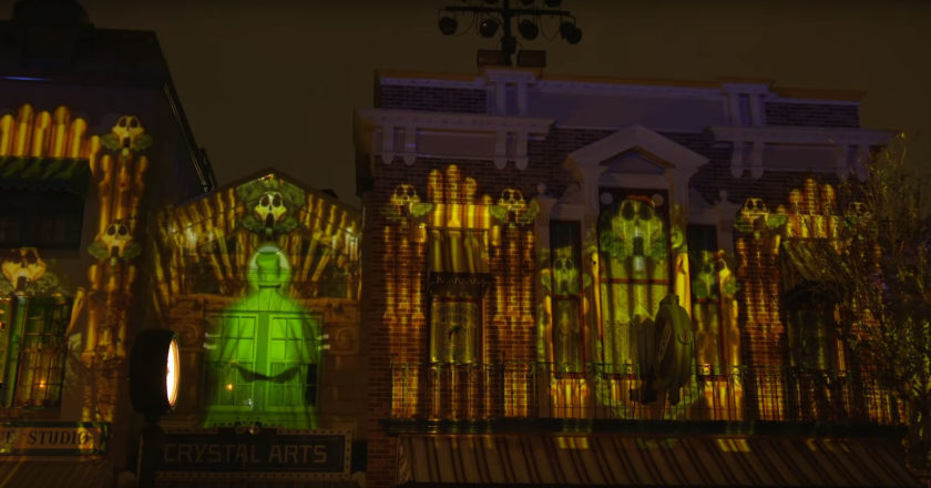 The organ ghost from the Haunted Mansion projected on Main Street U.S.A. during a preview performance of Mickey's Mix Magic